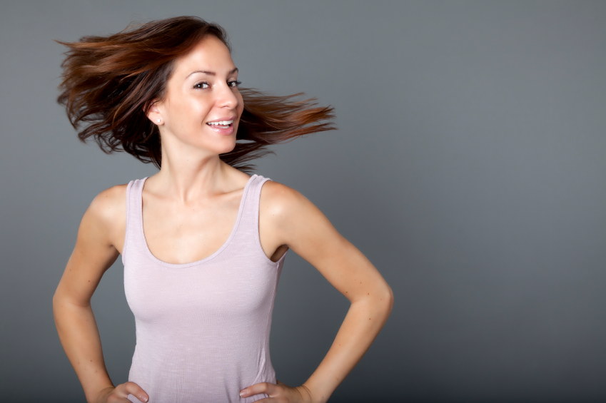 Healthy looking woman swinging her hair