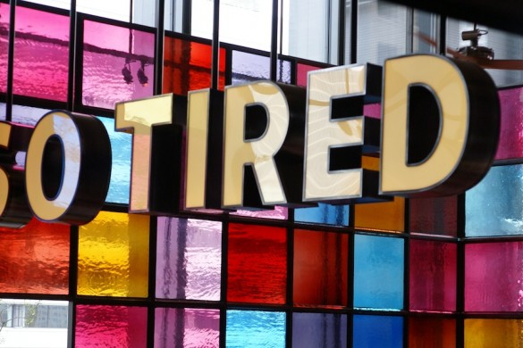 Colourful sign of the words So Tired