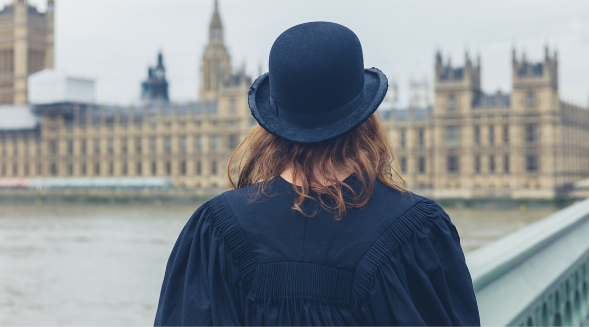 University graduate by Houses of Parliament