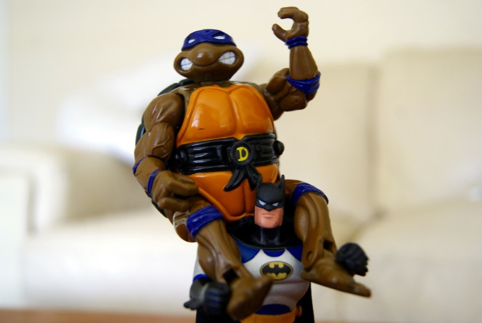 Batman carrying a Ninja Turtle