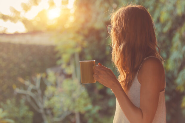 girl with coffee in garden