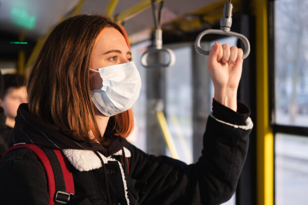 Woman in a protective mask on the train